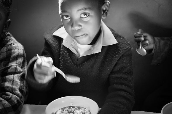 Boy eating at school | black and white photography